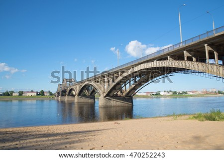 The road bridge in Rybinsk sunny day in july. View from the left bank of the Volga river