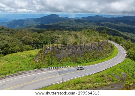 The road curves up Doi Inthanon.
