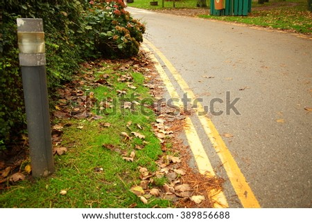 The road floor double yellow line on the road surface represent  the traffic sign and road signage concept related idea. - stock photo