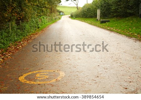 The road floor speed limit traffic on the road surface represent  the traffic sign and road signage concept related idea. - stock photo