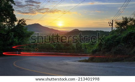 The road from the mountain with sunset behind, Rayong, Thailand - stock photo
