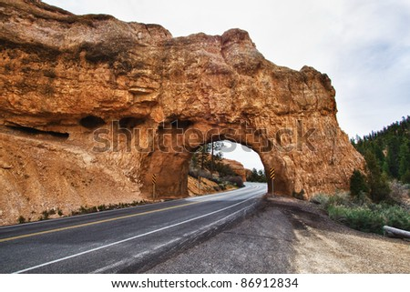 The road going through arch near Bryce Canyon National Park, Utah