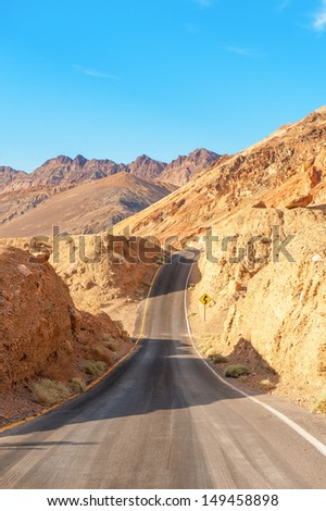 The road in death valley under the blue sky