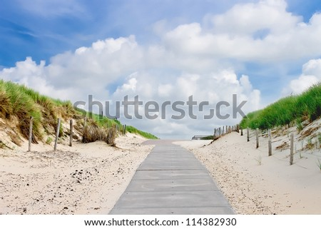The road in dunes to the beach. Netherlands - stock photo