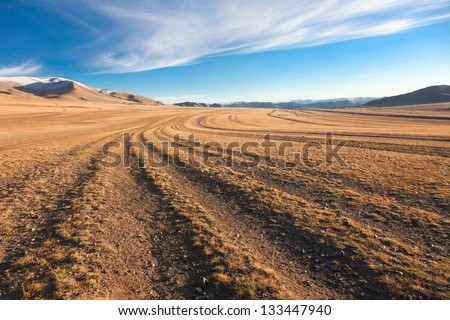 The road in the desert. Central Asia between the Russian Altai and Mongolia - stock photo