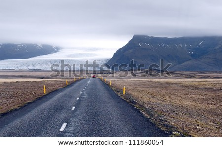 The road leading around the glacier fields in the mountains, Iceland - stock photo