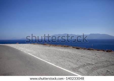 The road on Cos island near the Aegean Sea shore,Cos,Greece/ Road - stock photo