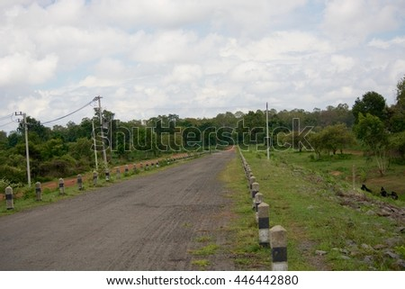 The road on the dam. - stock photo