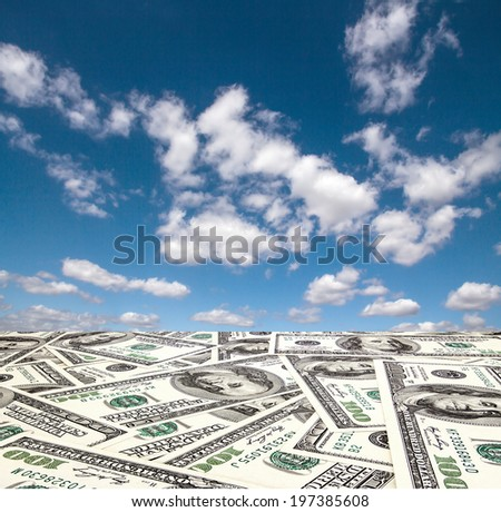 The road out of the dollar in the blue sky with clouds