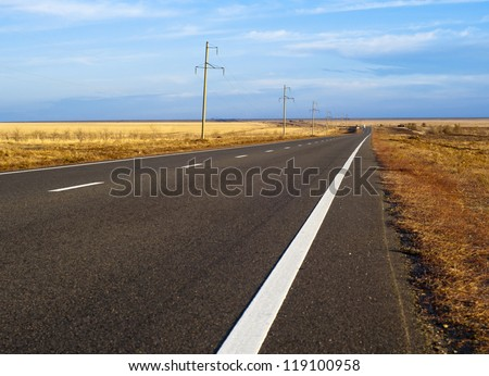 the road through the steppe. Way in asia. - stock photo