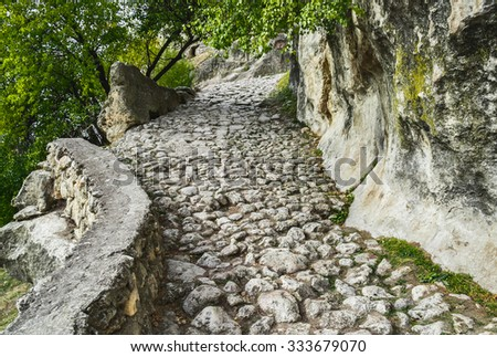The road to Chufut-Kale - medieval cave town in Crimean Mountain - stock photo
