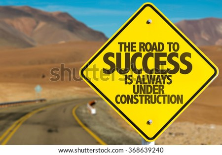 The Road to Success is Always Under Construction sign on desert road - stock photo