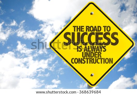 The Road to Success is Always Under Construction sign with sky background - stock photo
