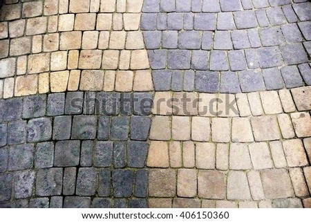 The road with two types of paving stones.