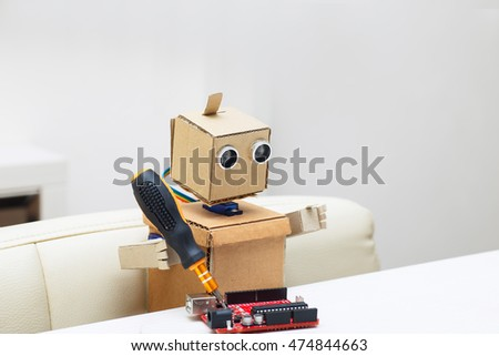 the robot holds a screwdriver