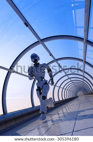 The robot runs on the glass corridor. - stock photo
