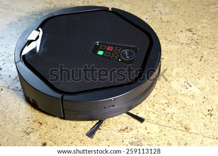 the robot the vacuum cleaner cleans a floor  - stock photo