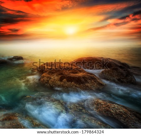 The Rock Hin ta from Thai island of Koh Samui. The picturesque pile of rocks on the beach, illuminated by the sunrise - stock photo