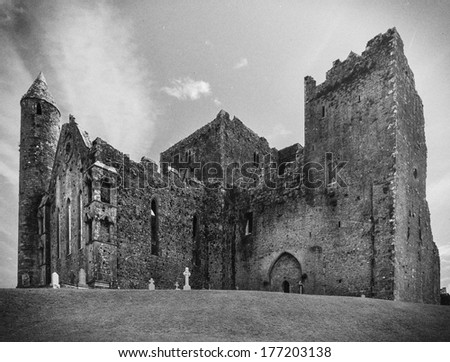 The Rock of Cashel,  the most visited Heritage site in Ireland processed with black and white vintage filter. - stock photo