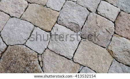 the Rock wall seamless texture - Background. Wall made of many stones with heterogeneous forms fitted together - stock photo