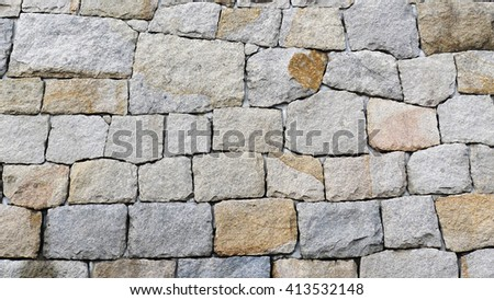 the Rock wall seamless texture - Wall made of many stones with heterogeneous forms fitted together - stock photo