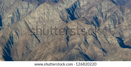The rocks in the mountains without vegetation - stock photo