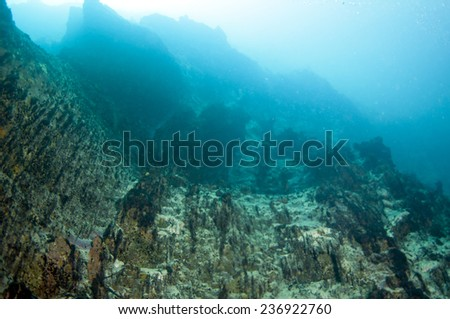 The rocks inside of hot spring, the different density of hot and cold water makes the vision blurry. Barracuda Lake, Coron, Philippines. - stock photo