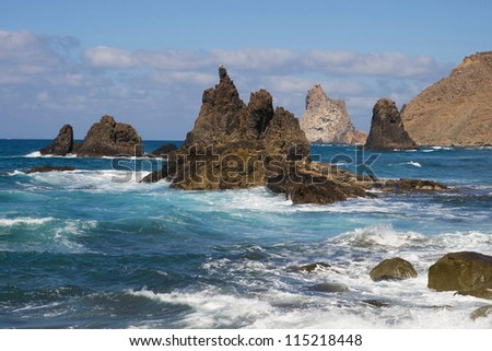 The rocky coast of Taganana with the formations of Los Roques de Anaga in the northeast coast of Tenerife, Canary Islands. - stock photo