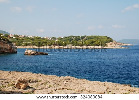 The rocky coastline at Patitiri on the Greek island of Alonissos in the Northern Sporades group. - stock photo