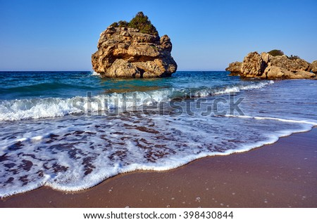 The rocky island off the beach on the island of Zakynthos in Greece - stock photo