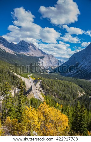 The Rocky Mountains of Canada, Banff National Park. Picturesque magnificent canyon in an autumn sunny day. Across the region to a canyon passes the excellent highway - stock photo