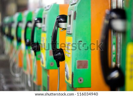 The roll of colorful public  phones in the railway station - stock photo