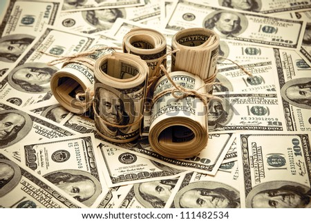 The rolls of US federal reserve notes $100. Old style photo. - stock photo