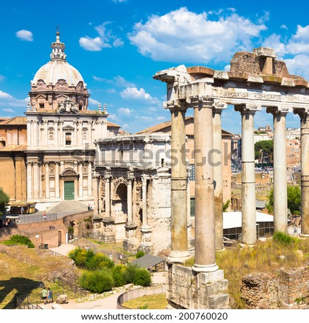 The Roman Forum also Foro Romano is a rectangular square surrounded by the ruins of several important ancient government buildings at the center of the city of Rome, Italy. - stock photo