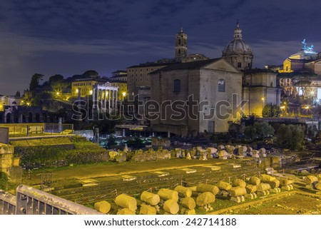 The Roman Forum is a rectangular forum (plaza) surrounded by the ruins of several important ancient government buildings at the center of the city of Rome. Evening - stock photo