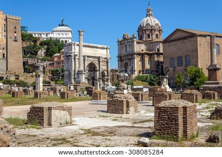 The Roman Forum, the rectangular forum (plaza) surrounded by the ruins of several important ancient government buildings at the center of the city of Rome, ITALY - stock photo