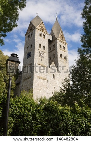 The Romanesque church in Dietkirchen an der Lahn, Germany. Dietkirchen an der Lahn is a borough of the Limburg an der Lahn city. The church bears the name of St. Lubentius.