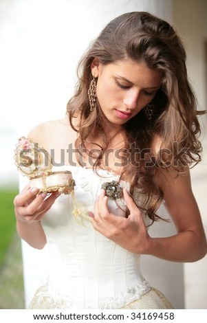 the romantic portrait of the princess with gift in hand - stock photo