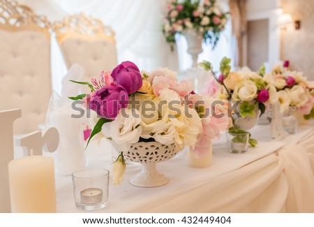 The romantic wedding decorated with stylish flower compositions from fresh flowers