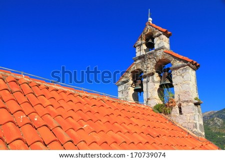 The roof and bell tower of orthodox monastery from the Adriatic sea area - stock photo