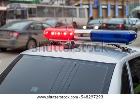 The roof-mounted lightbar of police car