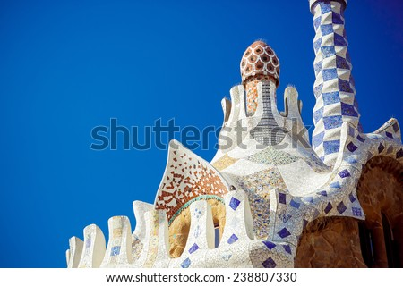 The roof of a gingerbread house in the Park Guell - stock photo