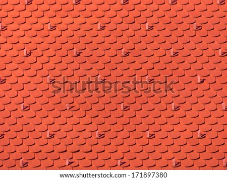 the roof of an old building (church) has been newly renovated. new tiles on house - stock photo