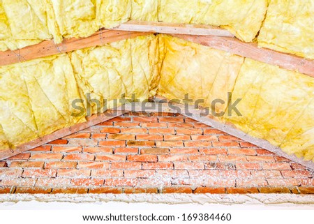 The roof of new house is being installed with environmentally friendly and energy efficient thermal insulation. - stock photo