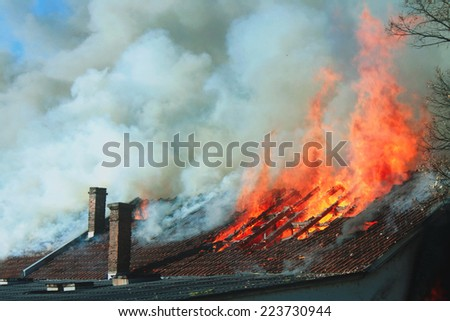 The roof on fire - stock photo