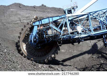 the rotary excavator, mining, shipping, digging, mining, steel bucket, mine, quarry, mechanism, black gold, coal, enterprise - stock photo
