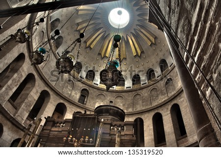 The Rotunda above the Edicule in the Church of the Holy Sepulchre in the old city of Jerusalem, Israel. Catholic belief claims this is the place was buried in after his crucifixion. - stock photo