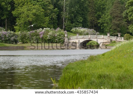 The rotunda and bridge in summer green park - stock photo