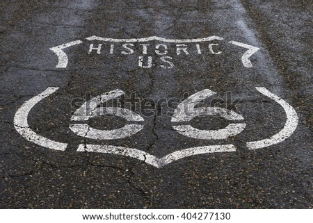 The Route 66 logo on the roadway. - stock photo