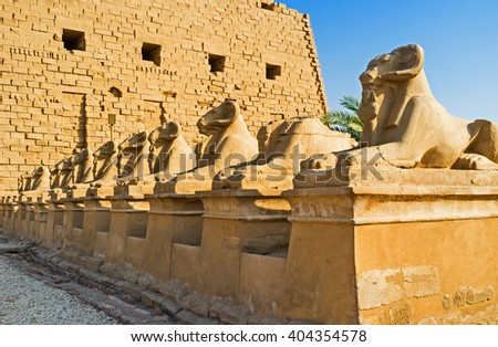 The row of the Ram Headed Sphinxes guard the entrance to the Karnak Temple in Luxor, Egypt.
